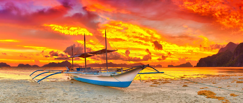 Boat at sunset royalty free stock photo