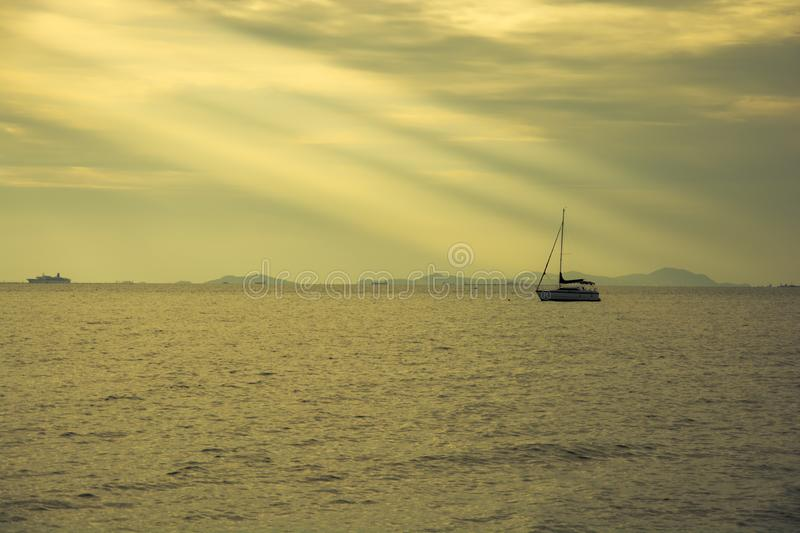 Boat in sunset, color effect stock images