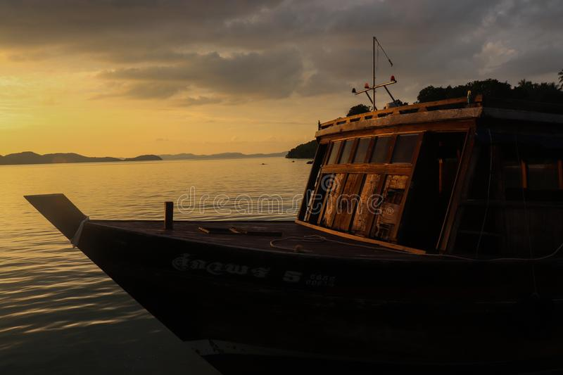 Boat with sunset stock images