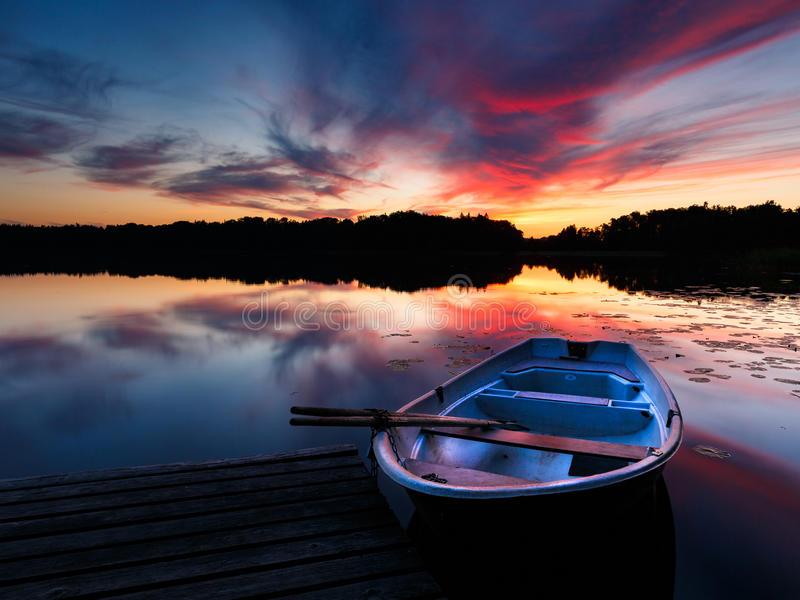 Boat and sunset stock photo