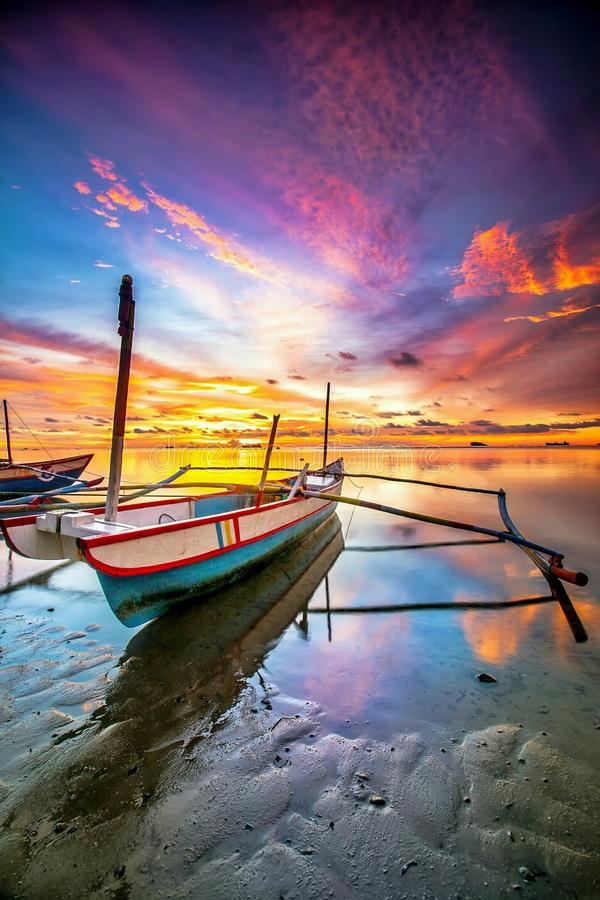 The boat. Boat and sunset at nirwana beach royalty free stock photography