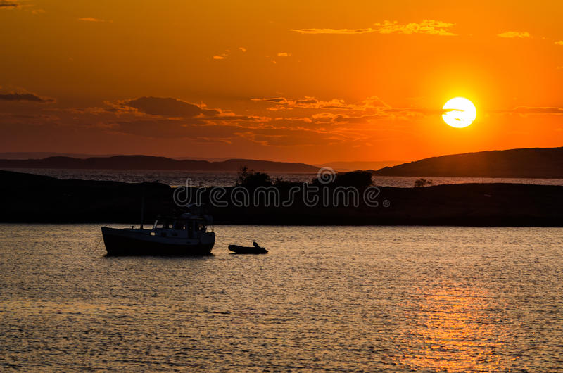 Boat in the sunset royalty free stock images