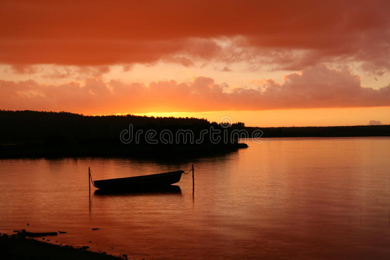 Boat at sunset stock photography