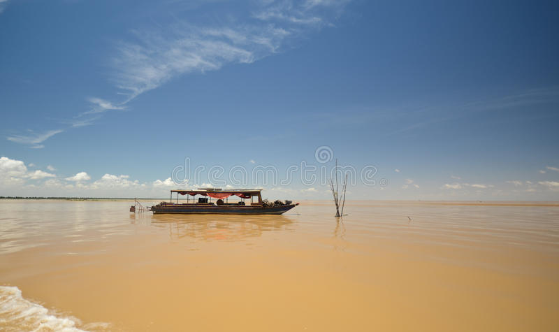 Boat on Tonle Sap lake. In Cambodia royalty free stock image