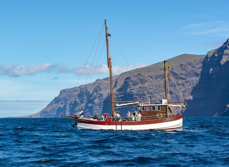 Boat with tourists near Los Gigantes looking for whales and dolphins, Tenerife, Canary islands, Spain stock images