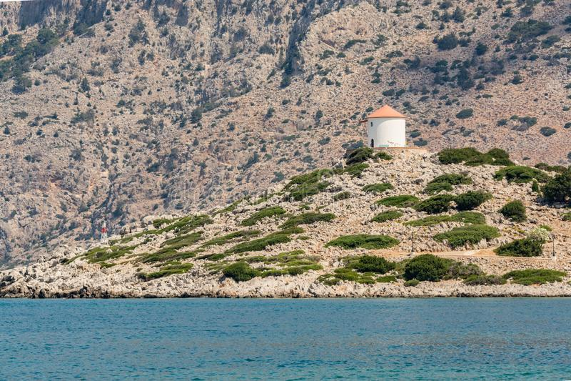 Boat trip along the shore of the island of Symi. The mountains and rocks of the island of Symi amaze with their grandeur and bewitching beauty. For many royalty free stock photos