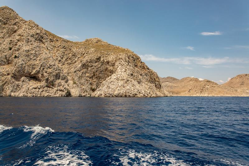 Boat trip along the shore of the island of Symi. The mountains and rocks of the island of Symi amaze with their grandeur and bewitching beauty. For many royalty free stock photography