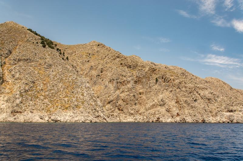 Boat trip along the shore of the island of Symi. The mountains and rocks of the island of Symi amaze with their grandeur and bewitching beauty. For many royalty free stock images