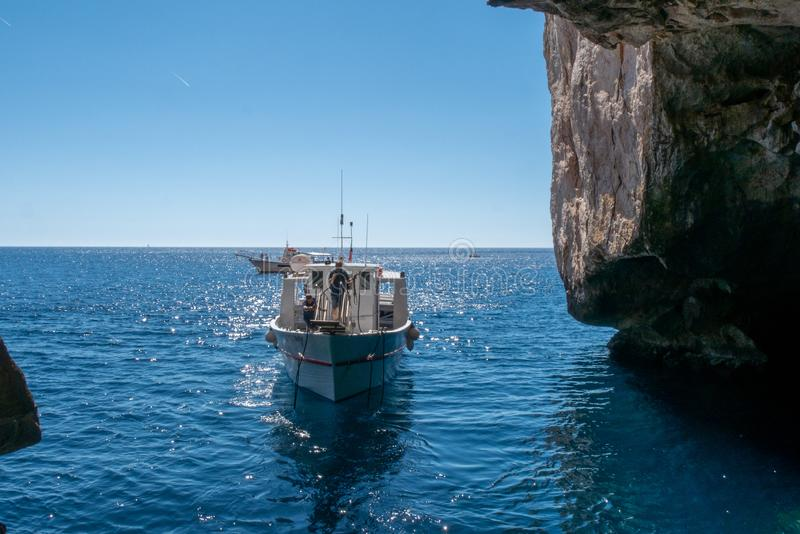 Boat trip around the grotta di nettuno royalty free stock photography