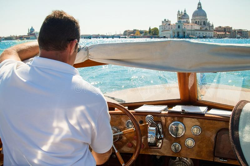 Boat trip on the big canal in venice. On a sunny day stock image
