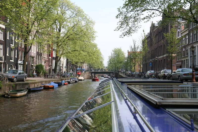 Boat trip on the picturesque canal. View of the canal from the boat. The Canals Of Amsterdam. Excursions in Amsterdam stock photos
