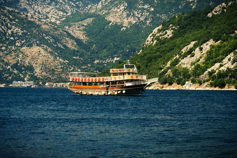 Boat trip, pleasure boat  along the Boko Kotor Bay with stunning views of the Balkan Mountains and the Adriatic Sea. Old Kotor, Montenegro - July 19, 2019 boat stock image