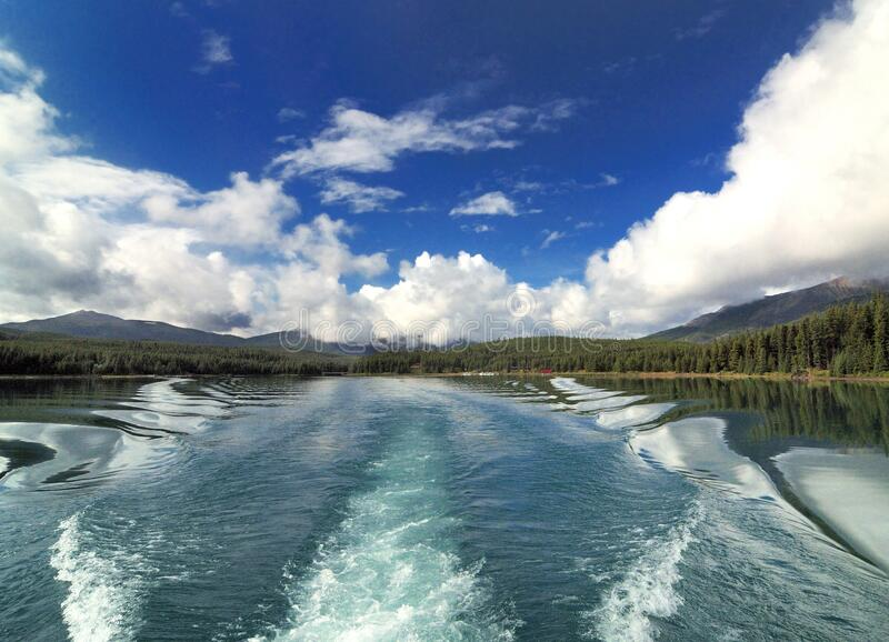 Boat Trip With View To The Stern Wave On The Lake Maligne Jasper National Park. Boat Trip On The Lake Maligne With View To The Stern Wave Jasper National Park stock image
