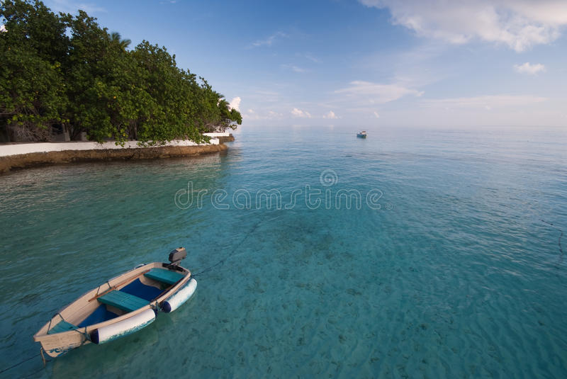 Boat At Turquoise Lagoon, Maldives Islands. Stock Photography