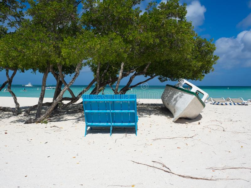 Boat under Divi Tree on the beach. Boat under Divi Tree on Eagle beach in Aruba royalty free stock photography