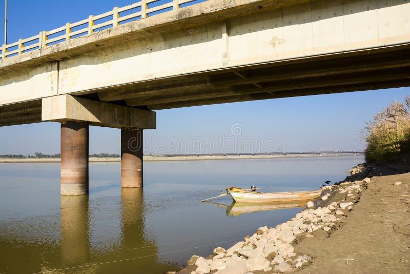 Boat under Khushab Bridge - Jhelum River. Khushab Bridge over Jhelum River located in Khushab, Punjab, Pakistan. Jehlam River or Jhelum River is a river that stock photos