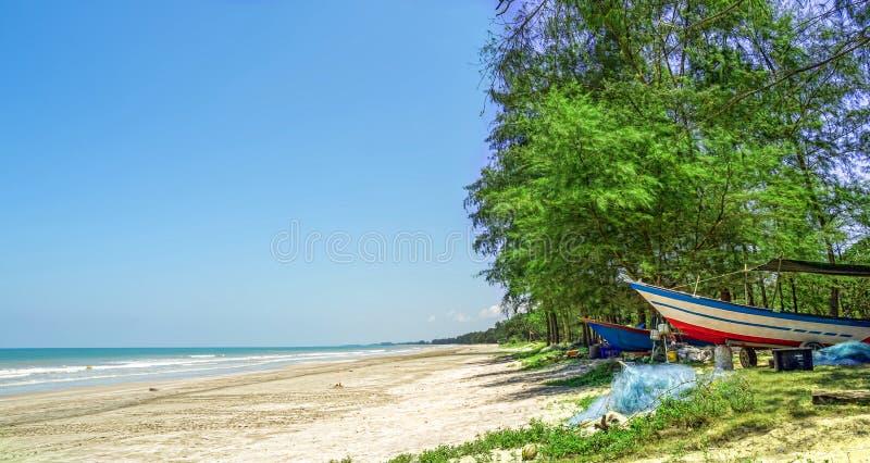 Boat Under Some Trees Near Beach Royalty Free Stock Photo