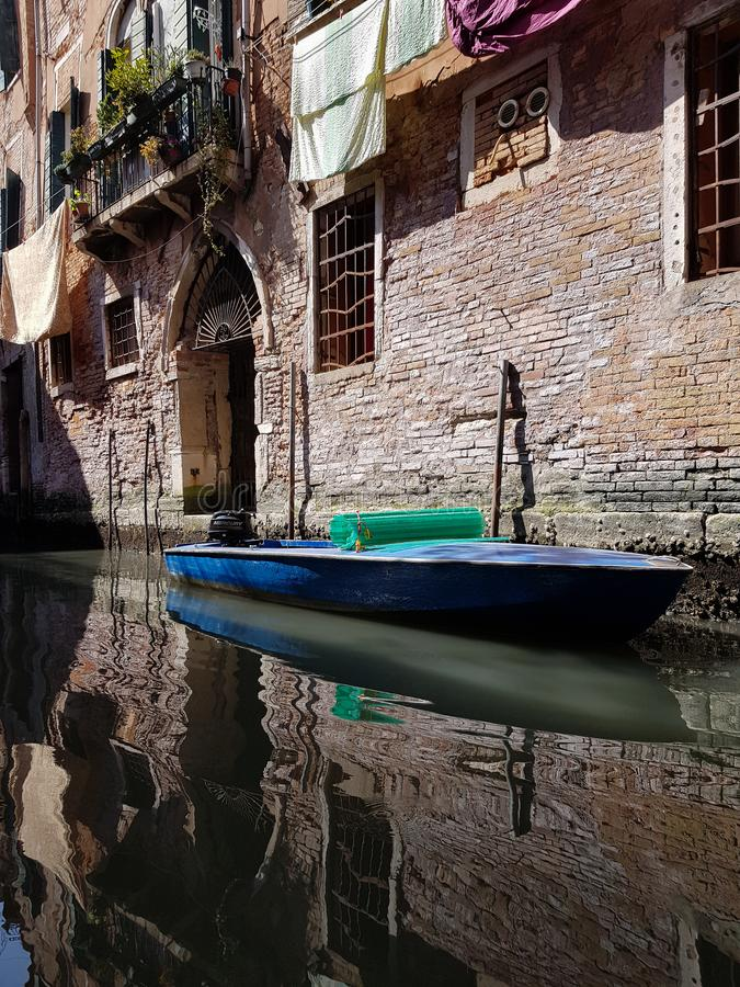Boat in a venetian canala royalty free stock photography