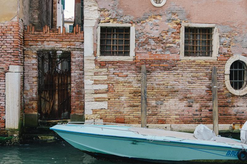 A boat in Venice. Many buildings in Venice are in a very alarming state. Still, the texture of the walls looks great royalty free stock photo