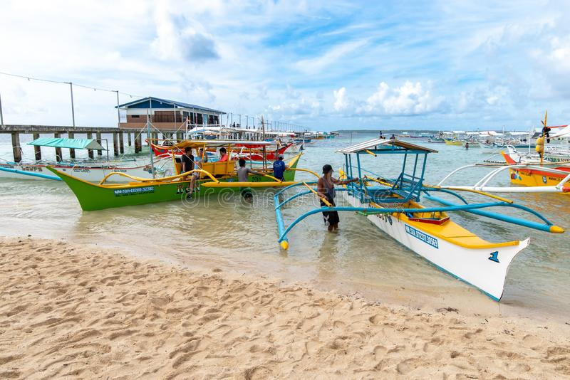 Boat waiting for tourists at General luna port, Siargao , Philippines, Apr 27, 2019. Apr 27, 2019 Boat waiting for tourists at General luna port, Siargao stock photography
