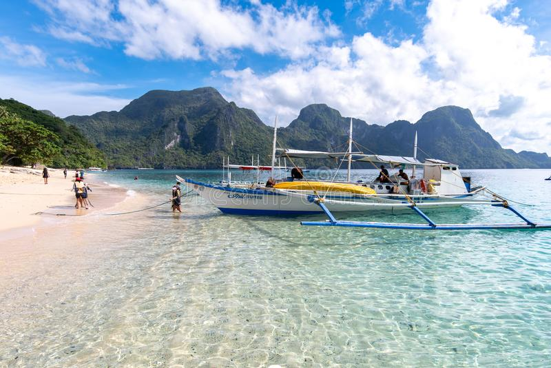 A boat waiting for a traveler on the Seven Commandos beach, Palawan, Philippines, Nov 18, 2018. Nov 18, 2018 A boat waiting for a traveler on the Seven Commandos royalty free stock photo