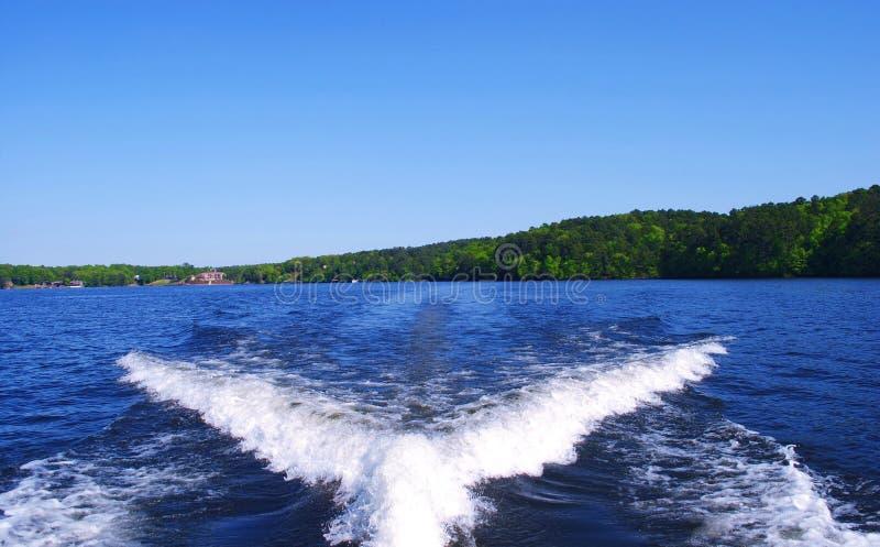 Boat Wake behind Ski Boat on Beautiful Lake Hamilton in Arkansas. On a sunny day stock photos
