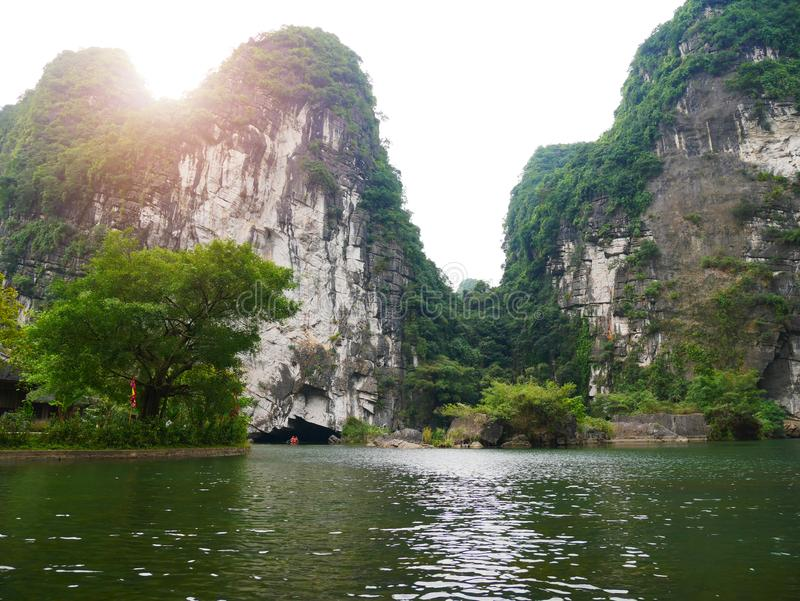 The boat that was paddling along the waterway with high mountains. In Halongbok, Vietnam royalty free stock photography