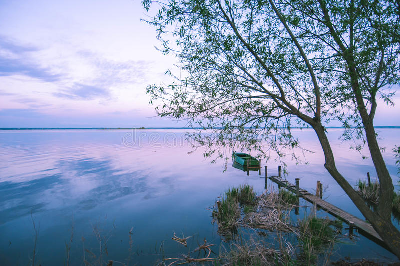 Boat on the water expanse of Lake Nero. At sunset stock photo