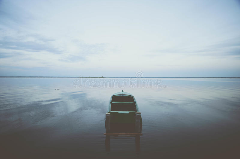 Boat on the water expanse of Lake Nero. At sunset stock photos