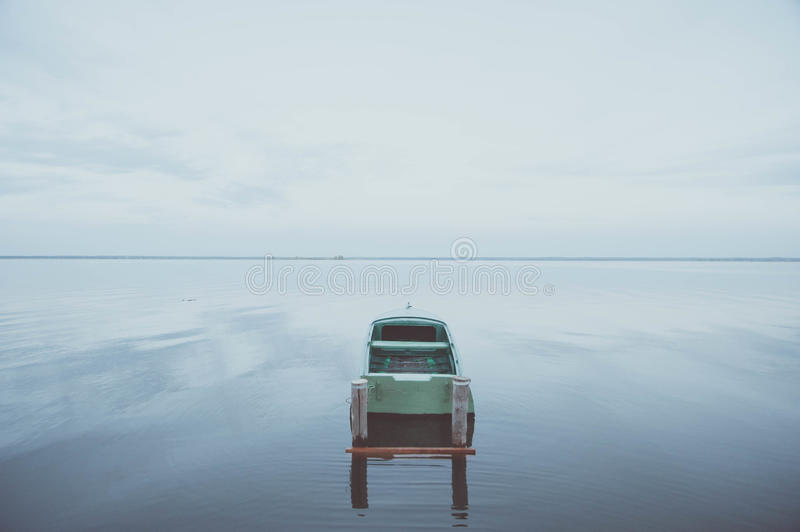 Boat on the water expanse of Lake Nero. At sunset royalty free stock image
