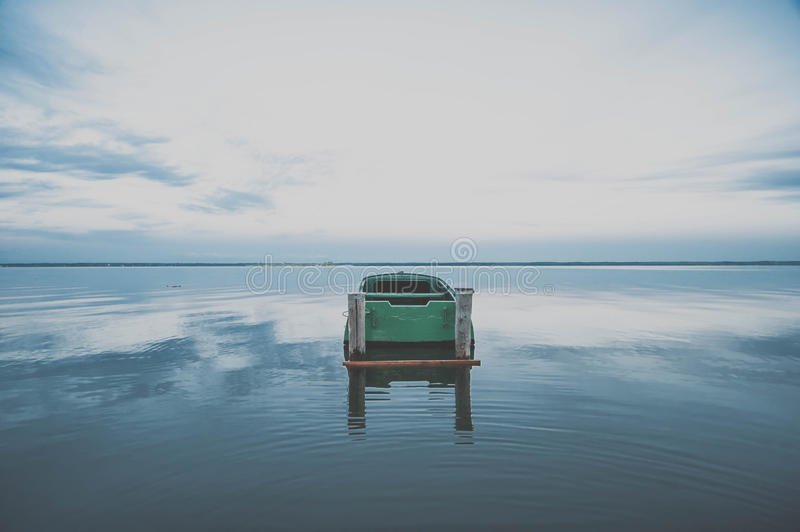 Boat on the water expanse of Lake Nero. At sunset stock images