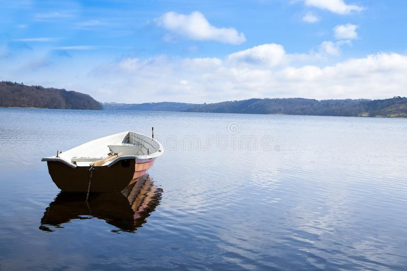 Boat on the water with reflection royalty free stock image