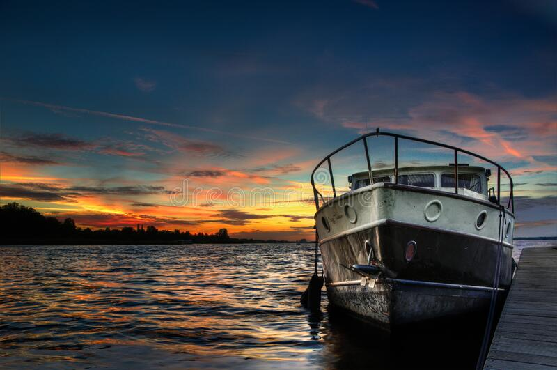 Boat in water at sunset royalty free stock photo