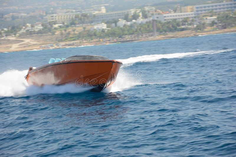 The boat on waves carries out turn at great speed.  royalty free stock image