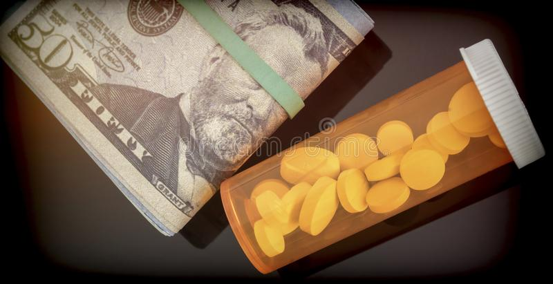 Boat of white pills along with tickets of dollar stock images