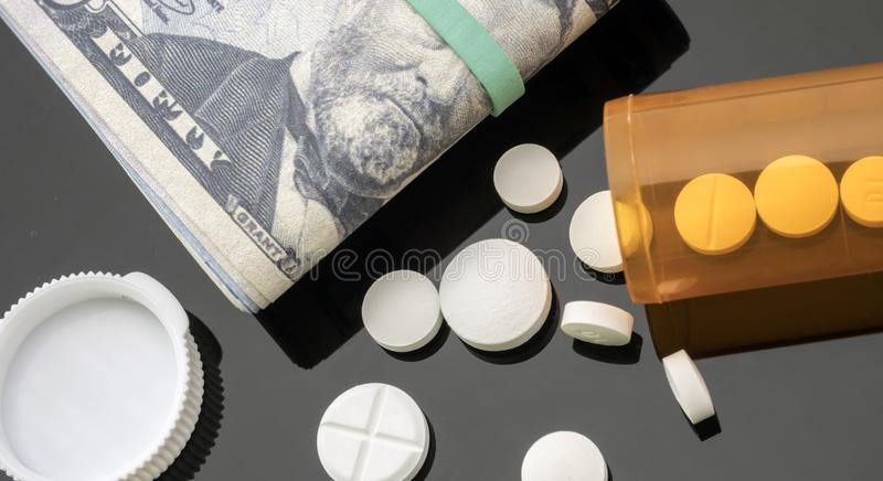 Boat of white pills along with tickets of dollar stock photo