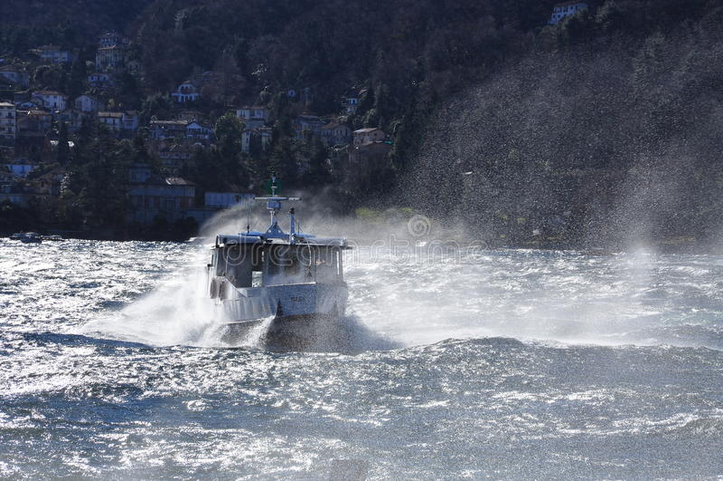 Boat on a windy lake. Splashing waves, lago Maggiore stock photo