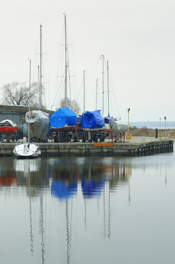 Boat, winter, dock, storage, boat, anchor, stand. Storing yacht during winter keeping of yachts, boats at the dock, winter storage royalty free stock photos