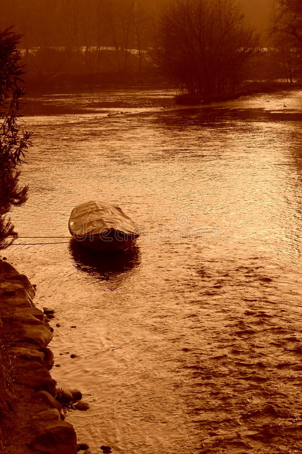 Boat on winter river stock images