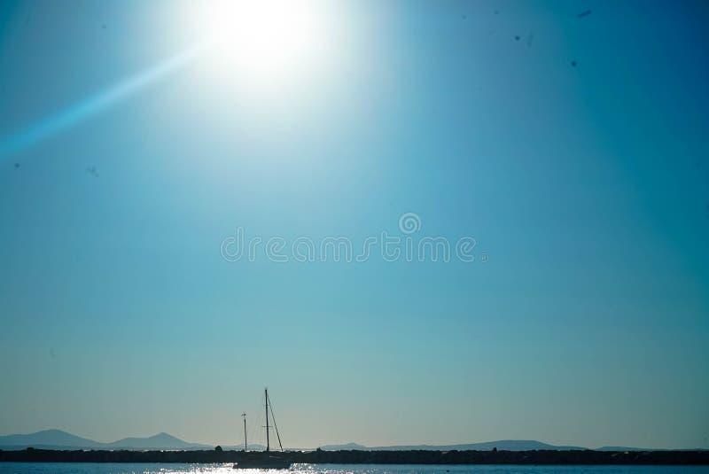 A boat wondering afloat near Naxos. A boat wondering afloat near the island of Naxos stock image
