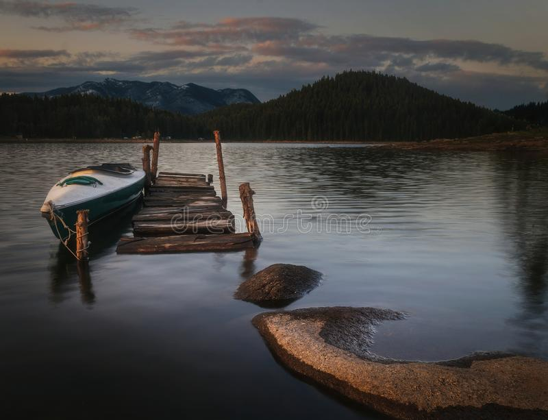Boat on Wooden Port stock photo