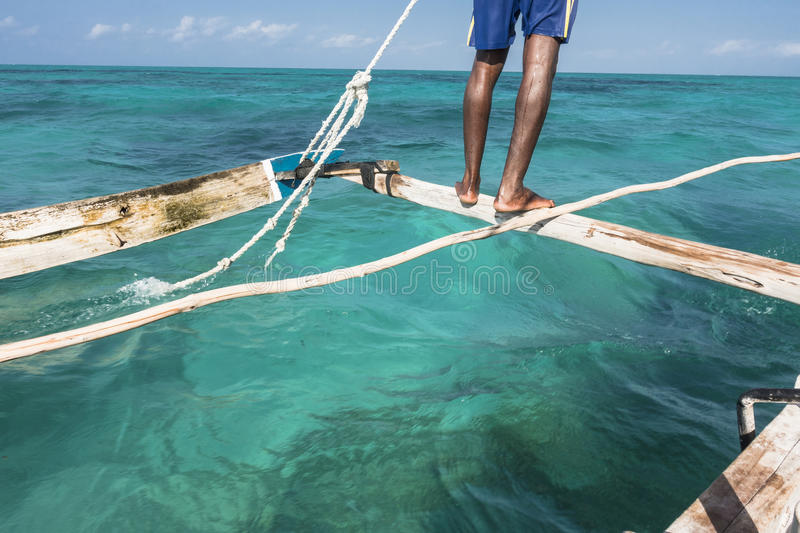 On the boat in Zanzibar. Fisherman sailing on the traditional boats on Indian Ocean in Zanzibar, Tanzania, Africa. Landscape from the boats royalty free stock photography