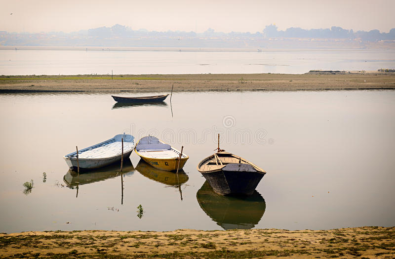 Boates in ganges in Allahabad, India. Four parked Boates in ganges in Allahabad, India stock photography