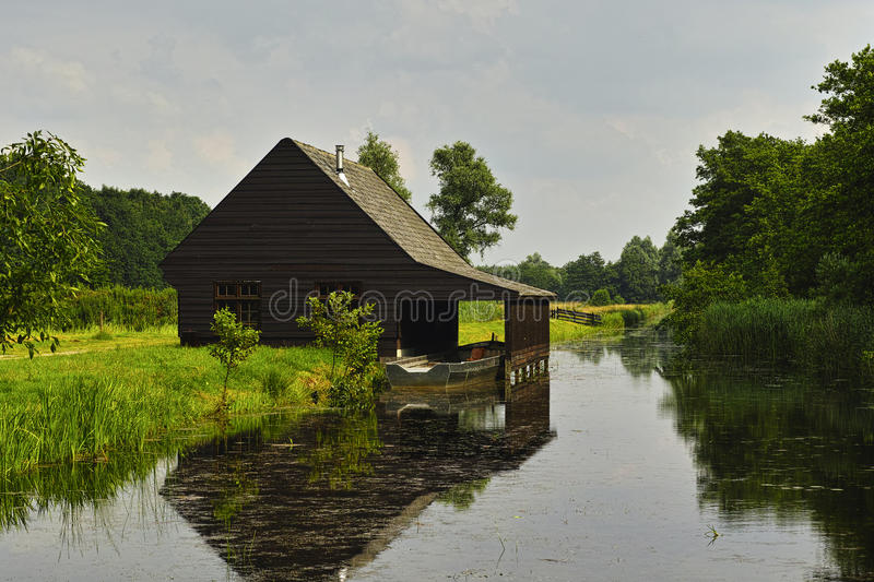 Boathouse along the water side. royalty free stock images