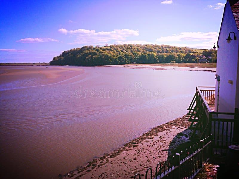Boathouse overlooking bay royalty free stock photo
