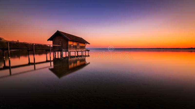 Boathouse in Stegen at the Ammersee at sunset in Bavaria Germany royalty free stock photos