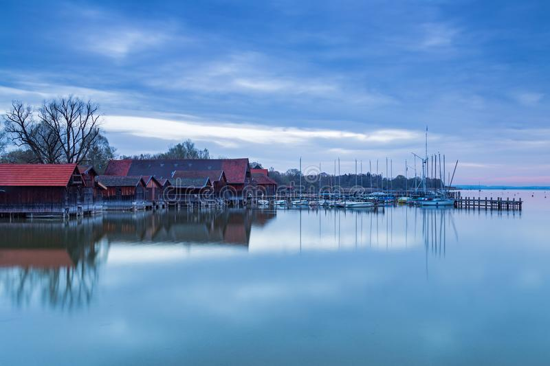 Boathouses at daybreak, Lake Ammersee royalty free stock photo