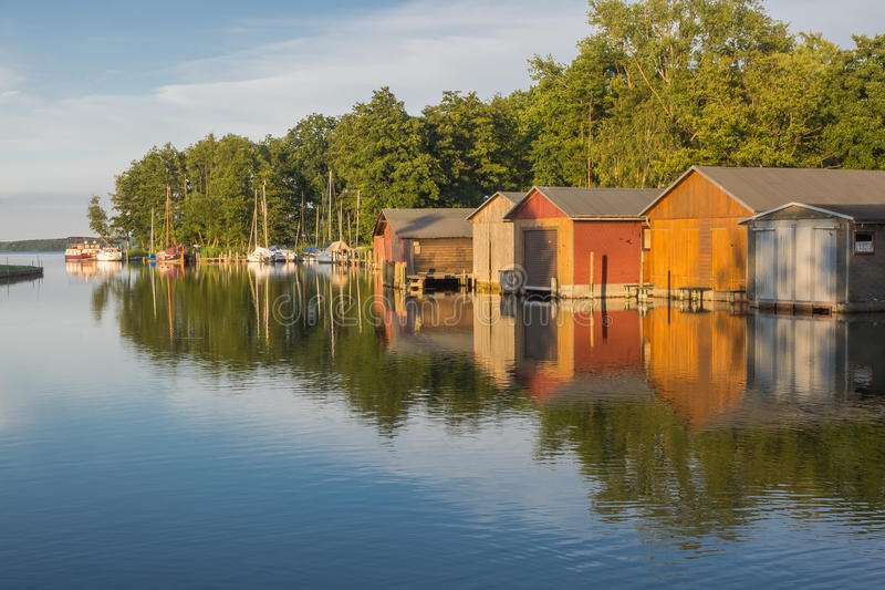 Boathouses at the mouth of river Elde to lake Plau, Mecklenburg-Western Pomerania royalty free stock photography