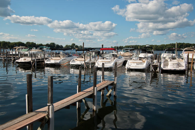 Boating Club on Lake Minnetonka, Minnesota. Boating clubs offer the use of new models of upscale boats without the hassle of owning, mooring, storing, or stock images