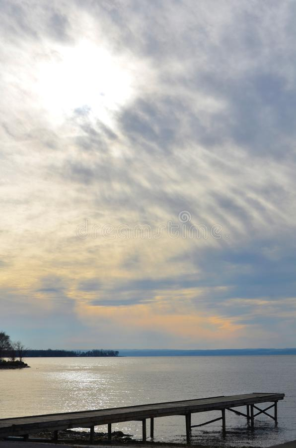 Cayuga Lake rainbow colored clouds at sunset. Boating dock and sunset clouds on Cayuga Lake in the southern Finger Lakes of NYS stock photo